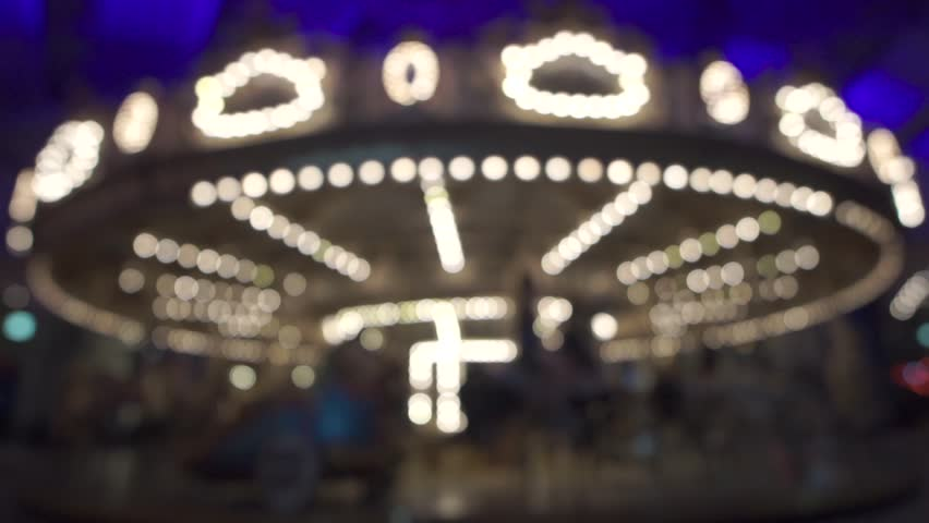 Defocused  lights of carousel horses at Melbourne luna park | Shutterstock HD Video #24892085