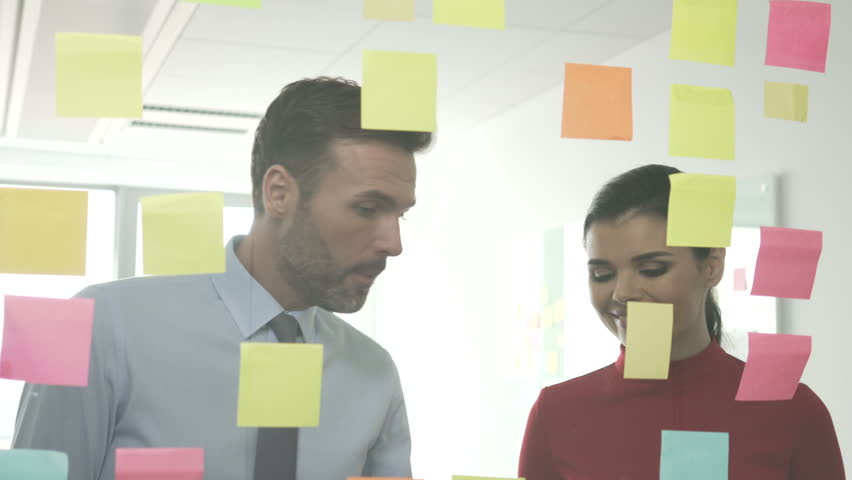 Creative employees working with sticky notes at office | Shutterstock HD Video #25050323