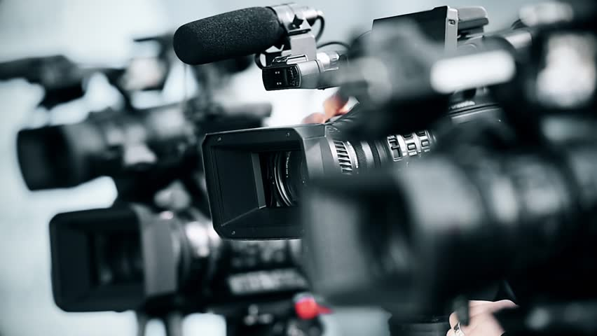 Television cameras in a row broadcasting a live media event | Shutterstock HD Video #25066235
