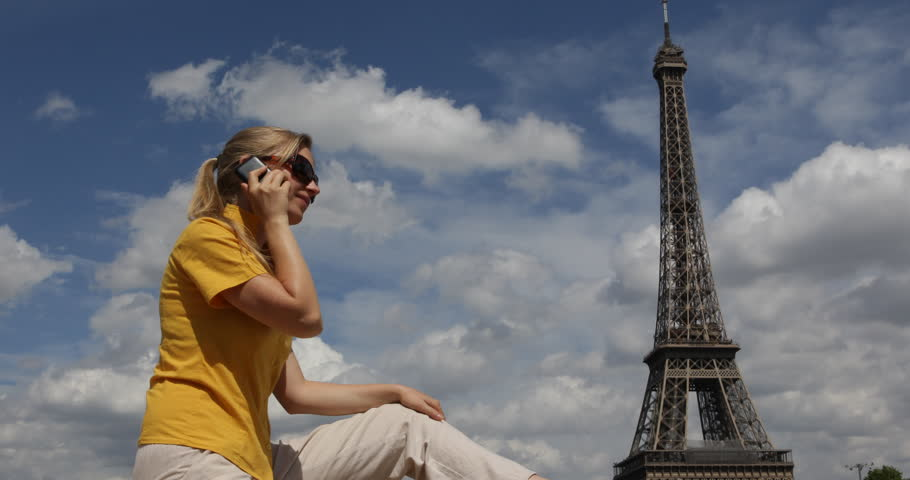 4K Business woman talk at mobile phone near Eiffel Tower holiday travel in Paris | Shutterstock HD Video #25075910