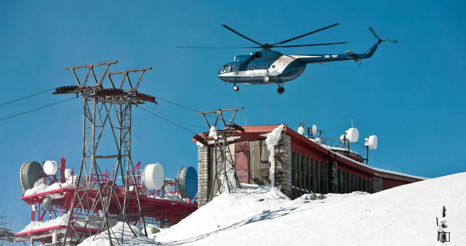 Helicopter under the radio weather station on top of mountain. Looping cinemagraph.   Shutterstock HD Video #25077908