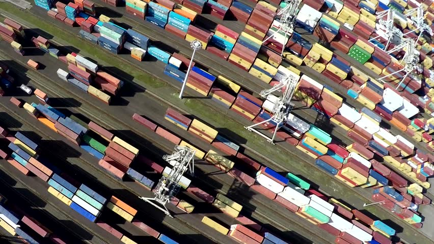 Aerial bird view of container terminal intermodal container is standardized shipping container designed and built for intermodal freight transport are used across different modes of transport 4k   Shutterstock HD Video #25113080