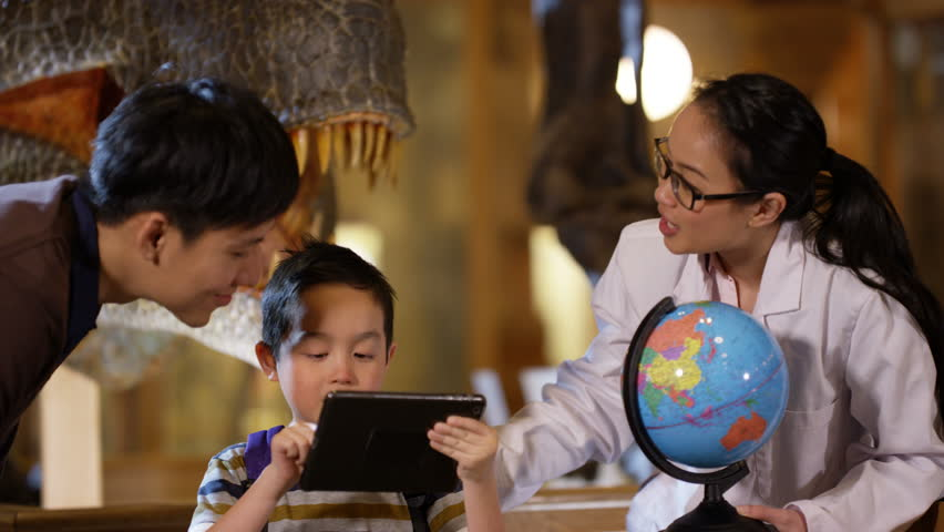4K Scientist in museum educating little boy who has computer tablet. | Shutterstock HD Video #25133402