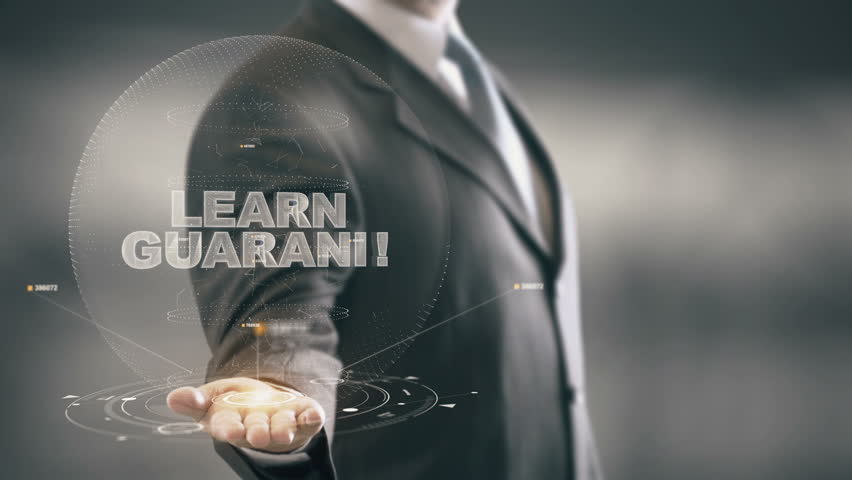Learn Guarani Hologram Concept Businessman Holding in Hand   Shutterstock HD Video #25135121