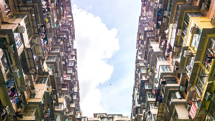 4k. Time lapse of Old Apartment with Moving Cloud in Hong Kong of China  | Shutterstock HD Video #25163552
