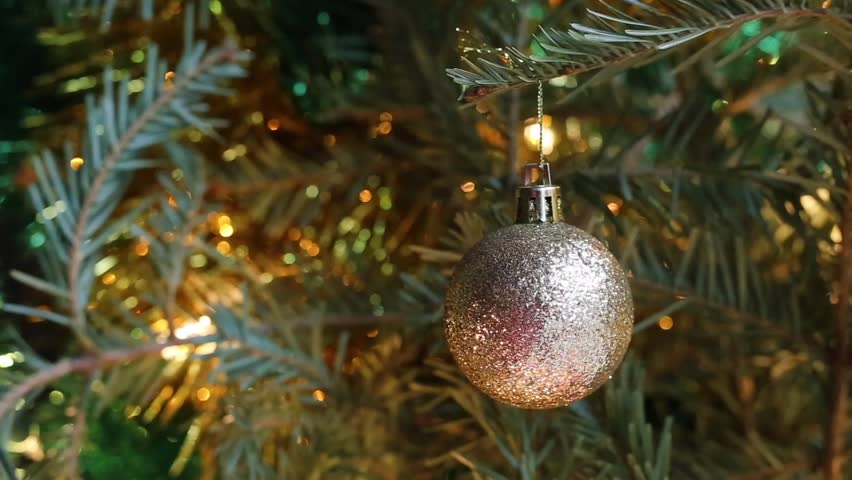 Christmas tree decoration against blurred Christmas tree background/Golden ball on Christmas tree branch | Shutterstock HD Video #25170527