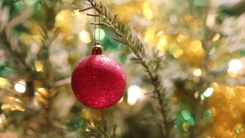 Christmas tree decoration against blurred Christmas tree background/Red ball on Christmas tree branch | Shutterstock HD Video #25170563