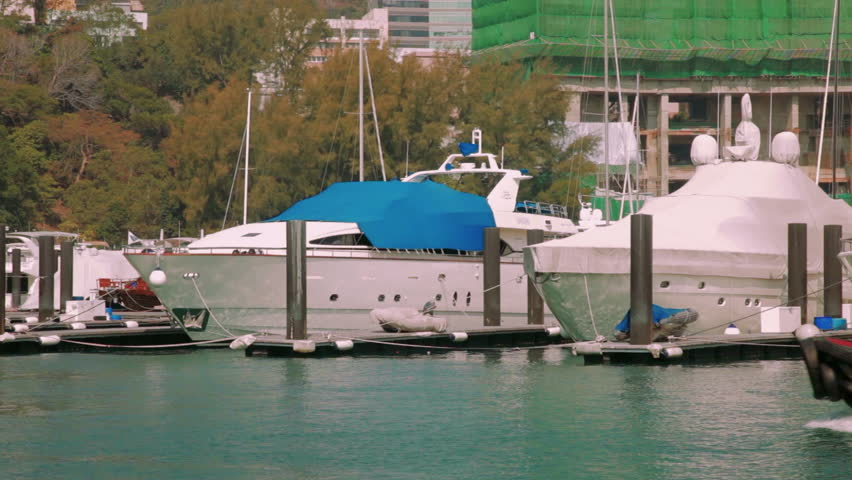 Junk boat in Victoria Harbour in Hong Kong on March 7, 2017. | Shutterstock HD Video #25182515