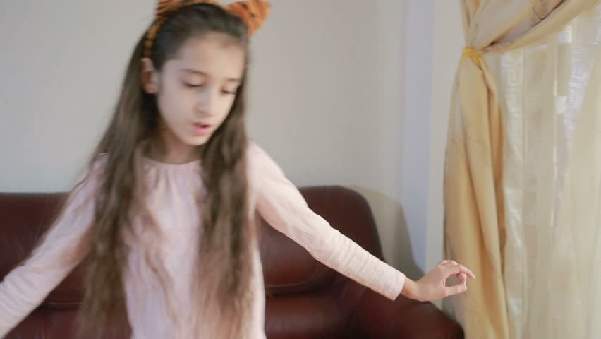 Little cute girl dancing and fooling around at home | Shutterstock HD Video #25183541