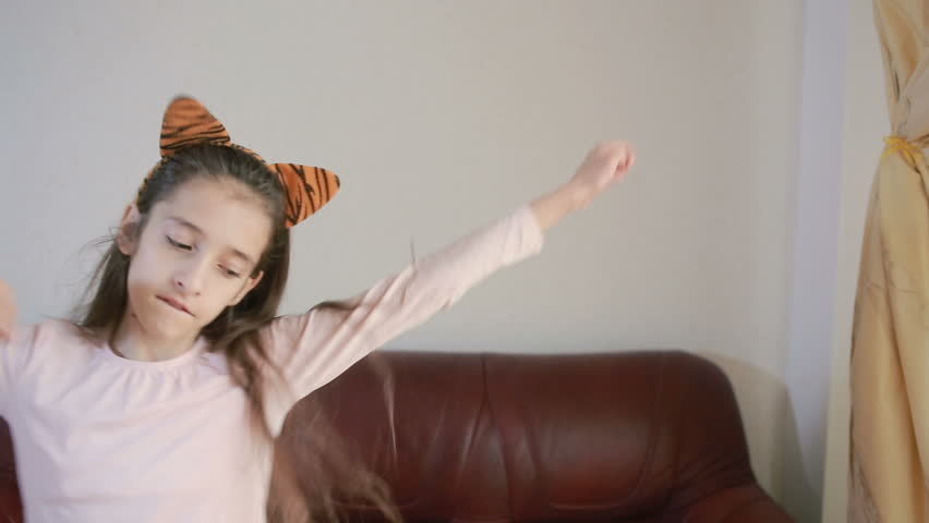 Little cute girl dancing and fooling around at home | Shutterstock HD Video #25183550