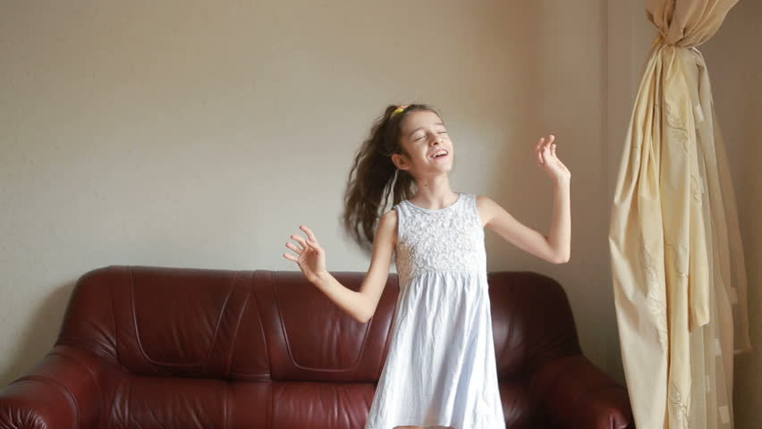 Little cute girl dancing and fooling around at home | Shutterstock HD Video #25183559