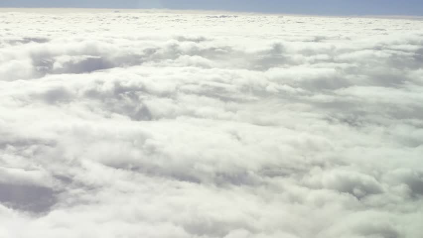 General view from the airplane window during a flight to fluffy thick clouds. Aerial shot. Traveling by air. | Shutterstock HD Video #25185521