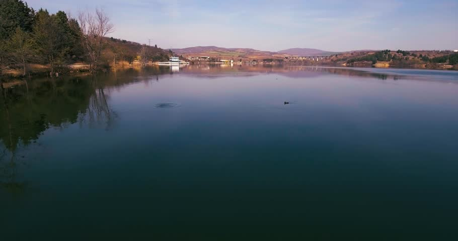 Low flight above lake Mladost- Veles town, Macedonia | Shutterstock HD Video #25185620