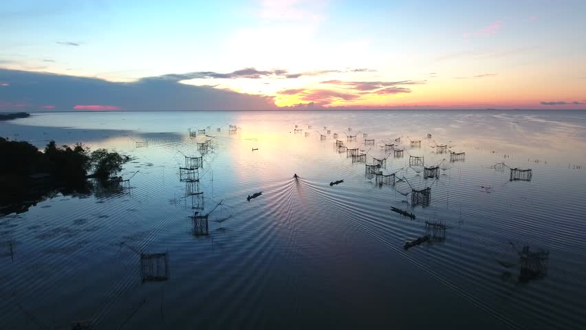 Drone top-view,Fisherman's way of livingin in Ban pak pra Phathalung,Thailand | Shutterstock HD Video #25185791