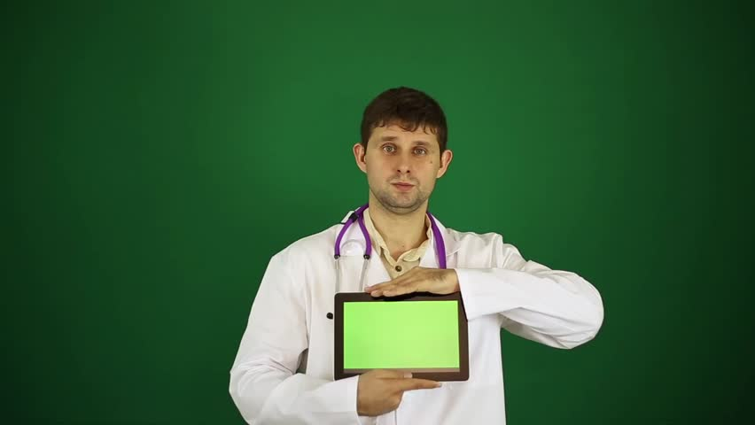 Male doctor in white lab coat. Doctor with a tablet computer. Doctor on a green background. Modern medicine, surgeon, treatment, new technologies. | Shutterstock HD Video #25209362