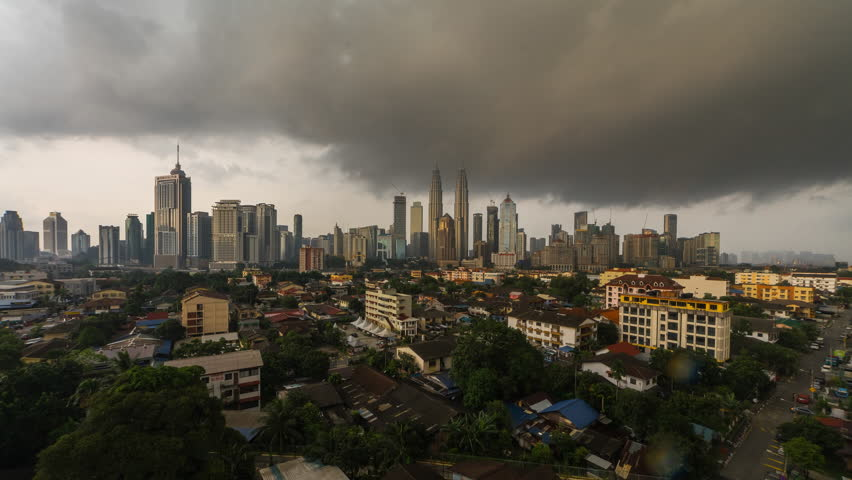 4k time lapse of dramatic weather scenery at Kuala Lumpur city. Moving and changing color clouds. Aerial view. | Shutterstock HD Video #25222043