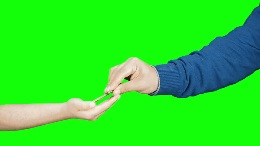 Kid adult hands handing over key concept  isolated green screen | Shutterstock HD Video #25222124
