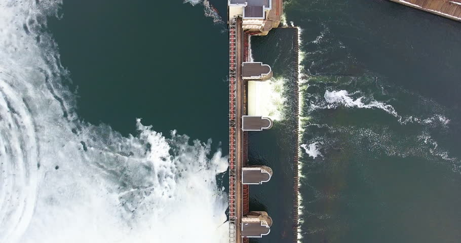 Water discharge of dam. Spring flood concept. Aerial view. | Shutterstock HD Video #25222997