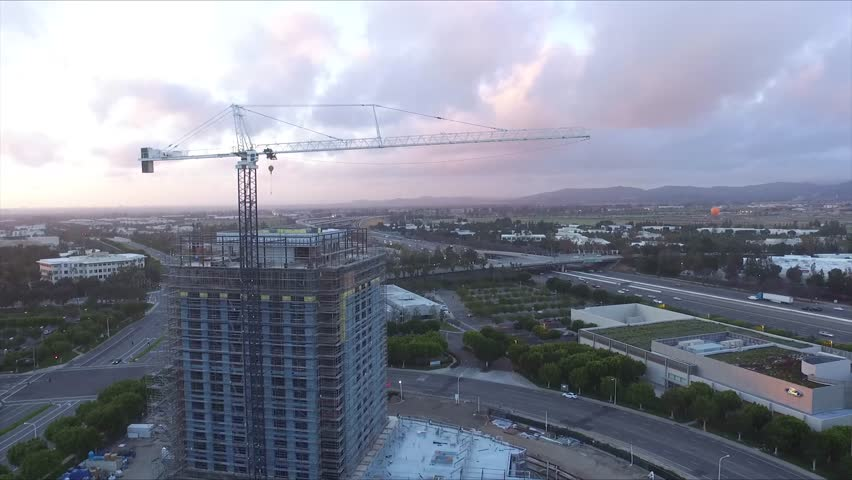 Aerial shot of crane over freeway with clouds in the sky stationary | Shutterstock HD Video #25228820