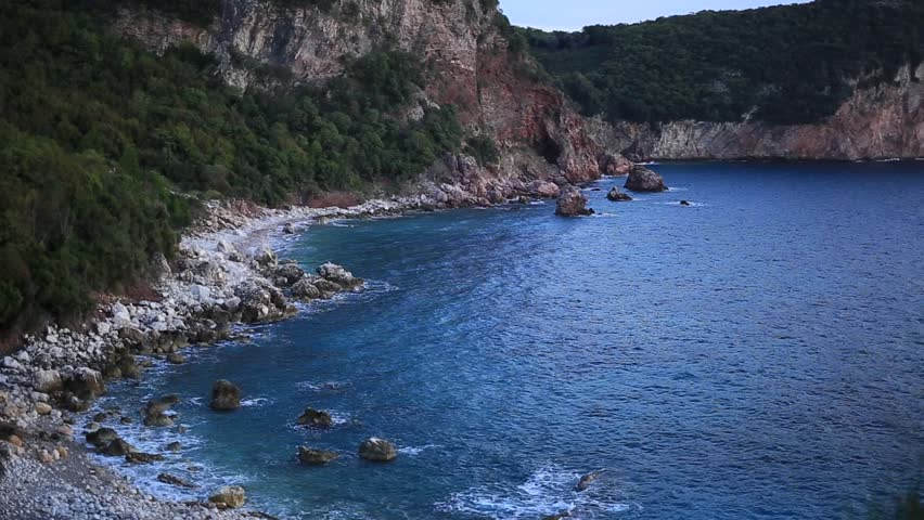 The beach Crvena Glavica in Montenegro. Wild beach, with a rocky coast. Aerial photography. | Shutterstock HD Video #25233581