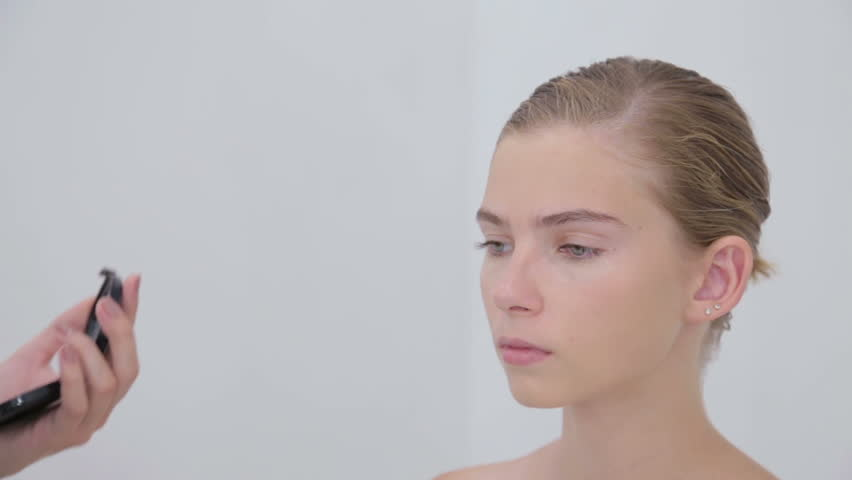 3 shots. Professional make-up artist applying powder to girl face in white room. Beauty, visage and fashion concept | Shutterstock HD Video #25234679