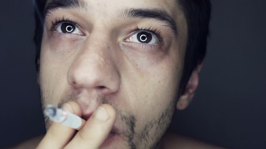 Smoking slow motion inhalation close up