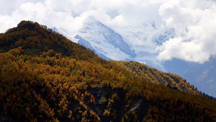 Fantastic massif in autumn season. Location place famous Mt. Ushba, Upper Svaneti Mestia, Georgia, Europe. High Caucasus ridge. Climate change. Explore the world's beauty. Shooting in HD 1080 video. | Shutterstock HD Video #25244381