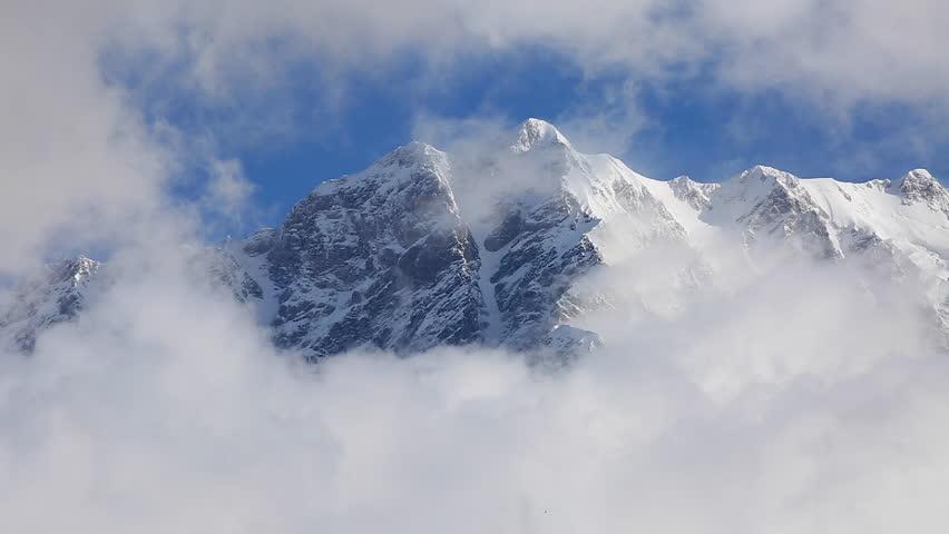 Fantastic white massif. Gorgeous scene. Location place Ushguli, Mt. Shkhara, Svaneti, Georgia country, Europe. Caucasus ridge. Climate change. Explore the world's beauty. Shooting in HD 1080 video. | Shutterstock HD Video #25244399