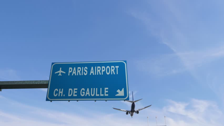 Paris airport sign airplane passing overhead   Shutterstock HD Video #25267160