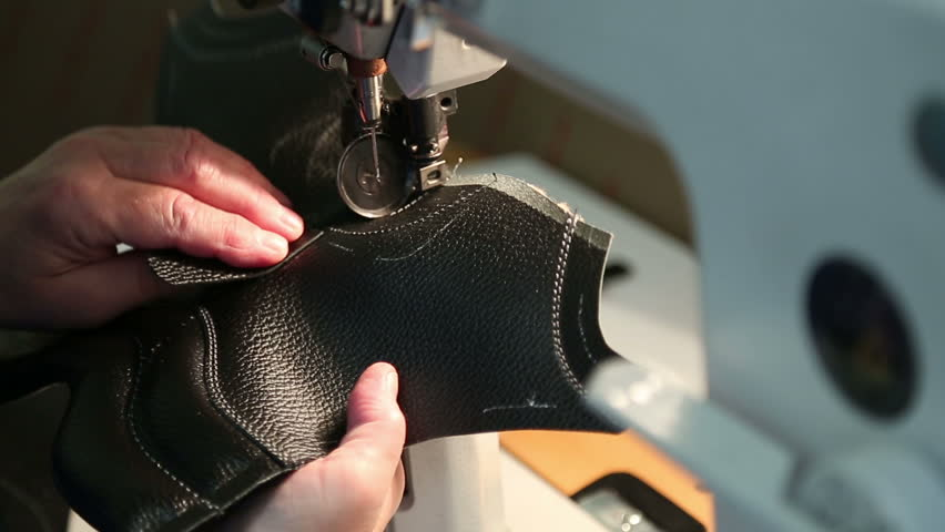 Shoe factory stitching of the Shoe on the sewing machine. | Shutterstock HD Video #25276619