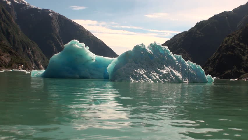Moving Ice Floes on background of mountain and water Pacific Ocean in Alaska. Amazing landscapes. Beautiful rest and tourism in a cool climate. Unique picture of nature in America. | Shutterstock HD Video #25328702