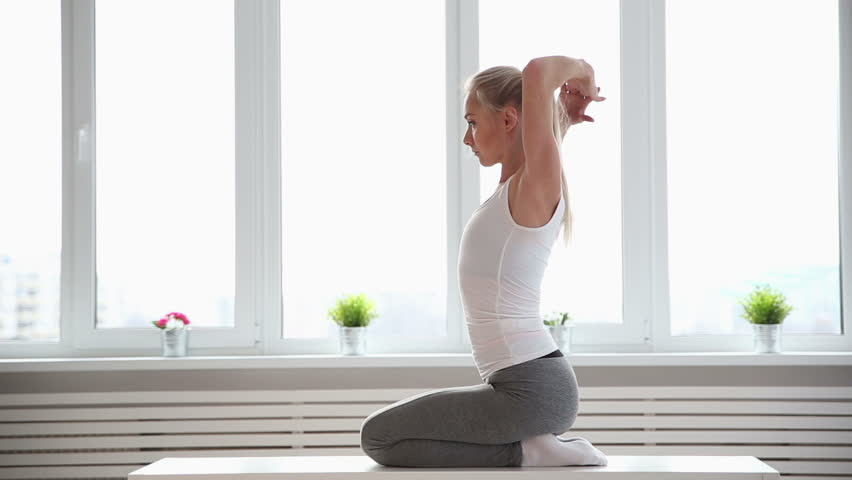 Fitness, sport, power-lifting and people concept - stretching young woman in the gym | Shutterstock HD Video #25334759