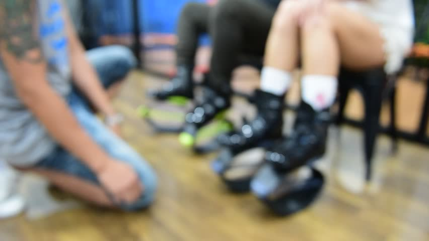 Blurred of an unidentified group of woman  doing exercises fitness with kangoo shoes.The best background for use.   Shutterstock HD Video #25335074