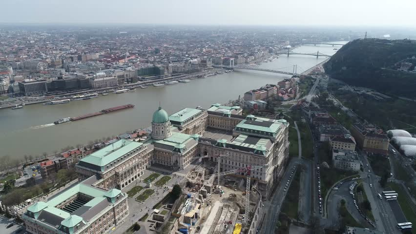 Aerial View of Budapest Royal Palace and surrounding Tourist Attractions and public Areas by the River Donau | Shutterstock HD Video #25338386