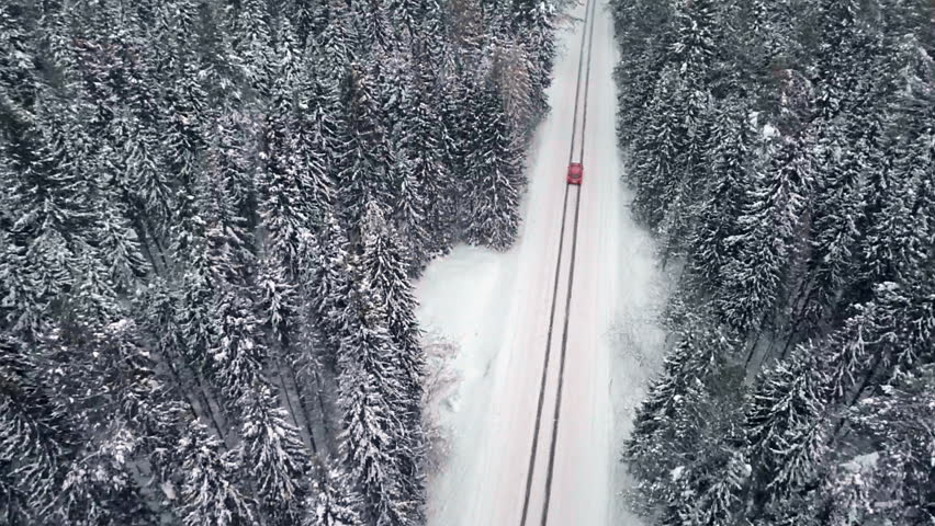 Aerial of a sports car on a winter road | Shutterstock HD Video #25341347