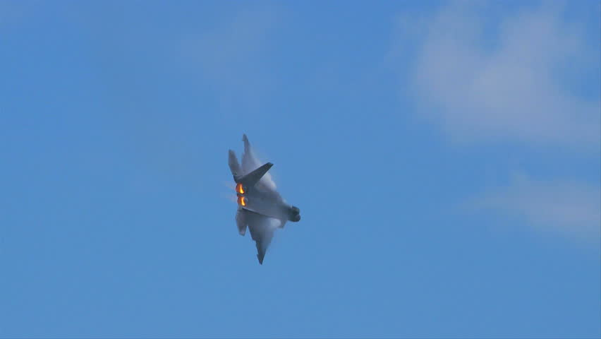 QUONSET, RHODE ISLAND - JUNE 2012: Air force F-22 Raptor with vapor on wings and after-burners at the Rhode Island National Guard Open House and Air Show in June 2012.