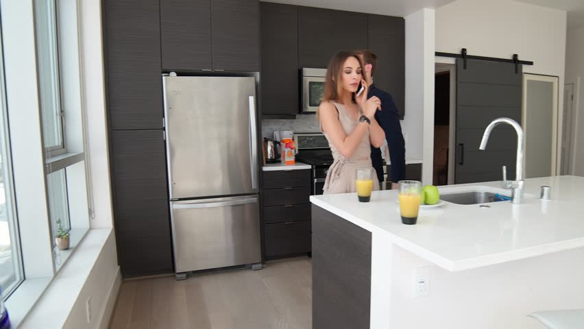 Business couple in the modern home talking on phone, busy lifestyle / Shot on Red Epic | Shutterstock HD Video #25344776