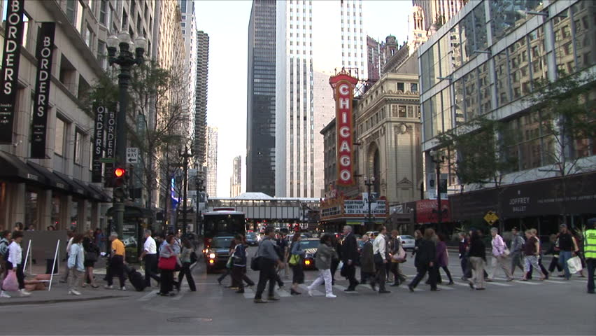 Chicago, IL - CIRCA September 2007: Pedestrians cross the busy intersection with the Chicago Theater behind it during the day - HD stock video clip
