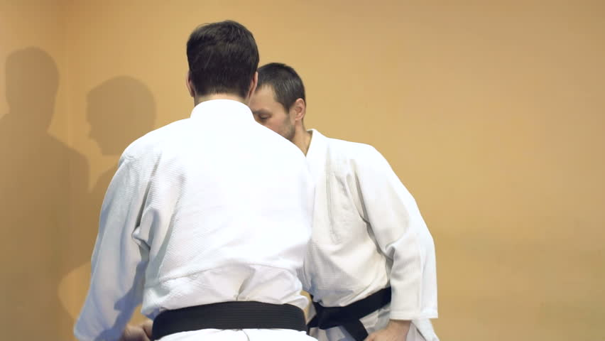 Two men practicing Aikido in the gym. Judo sport training in the sports hall. | Shutterstock HD Video #25357844
