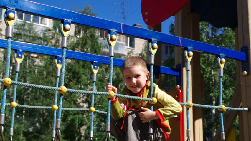 Cute little boy  playing in a children playground . - HD stock footage clip