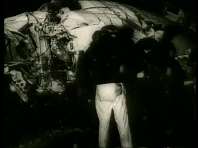An airplane's wreckage at night near Munich, West Germany circa February 1958. Manchester United soccer team was on board - MGM PICTURES, UNIVERSAL-INTERNATIONAL NEWSREEL, USA, filmed in 1958 - SD stock footage clip