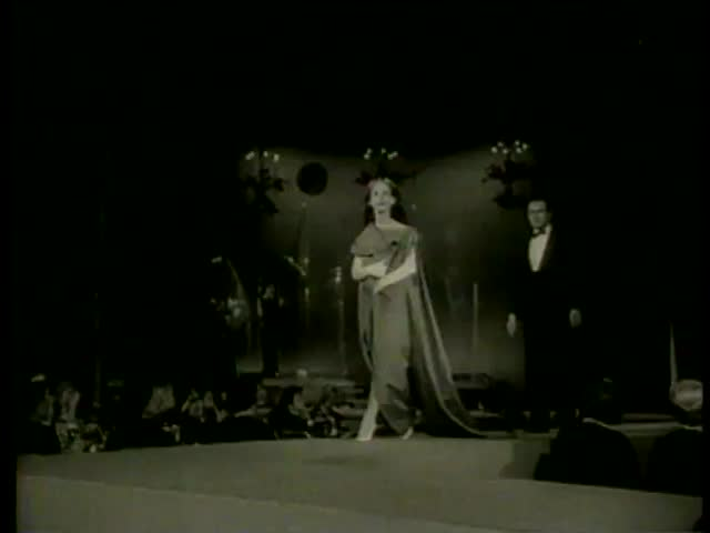 Models walk the runway at the Gala Style Show for the March of Dimes Polio Fight in New York circa 1958 - MGM PICTURES, UNIVERSAL-INTERNATIONAL NEWSREEL, USA, filmed in 1958