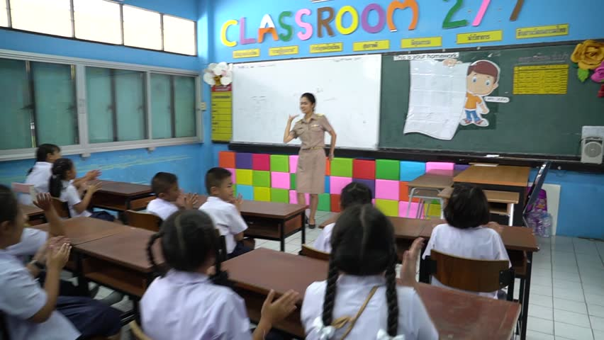SAMUTPRAKARN, THAILAND - MARCH 24, 2017 : Thailand teacher are teaching students with fun and happiness, teacher and student in uniform | Shutterstock HD Video #25470713