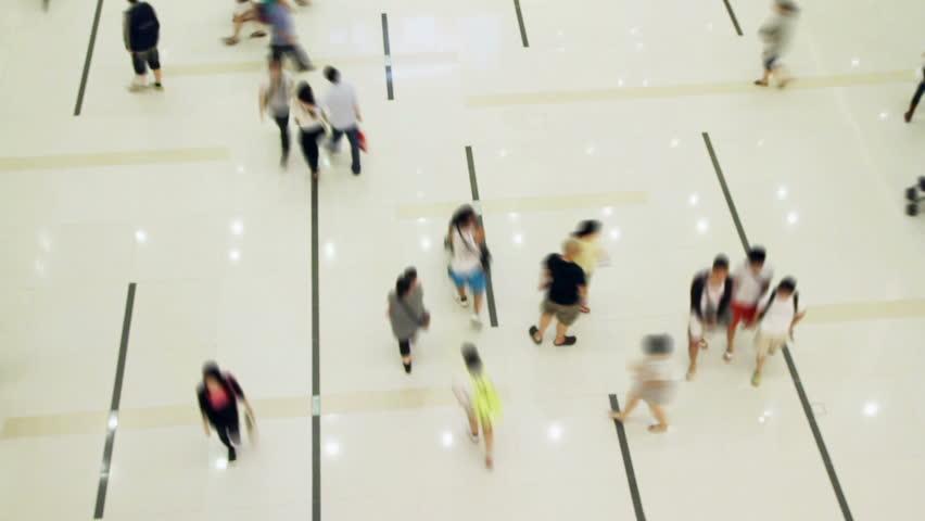 Blur of crowd walking through shopping center