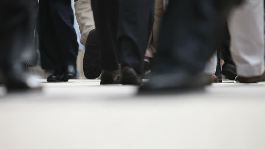 Sidewalk view of people walking showing just feet - HD stock footage clip