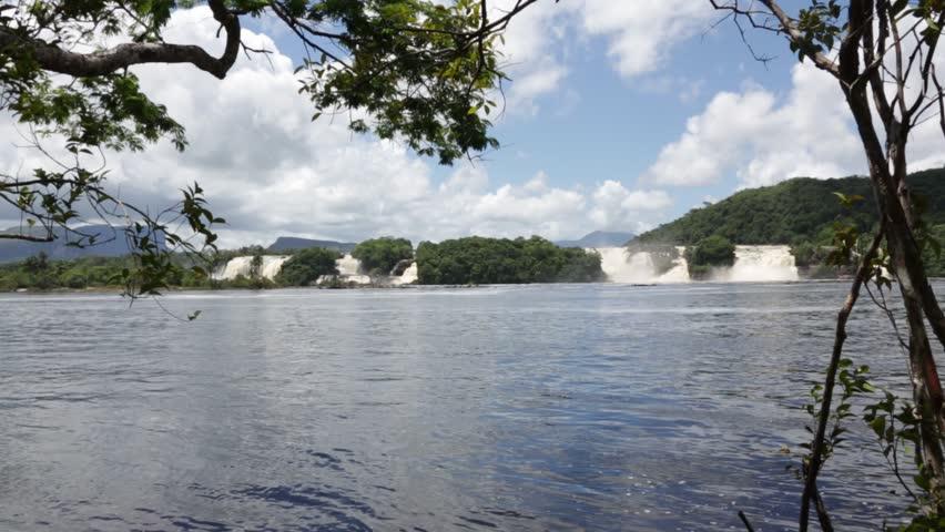 Panoramic view of waterfalls in the lagoon of the Canaima national park - Gran Sabana, Venezuela, Latin America - HD stock video clip
