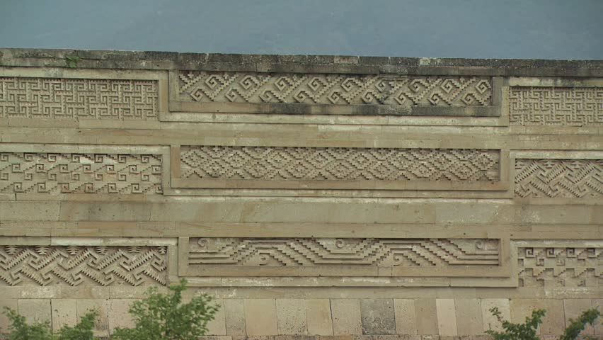 Ancient wall in mexico with intricate carvings stock