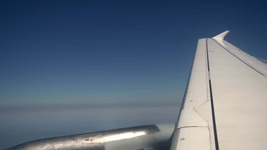 Wing of a flying aircraft over mountains, 4K Aerial Video Footage #25617899