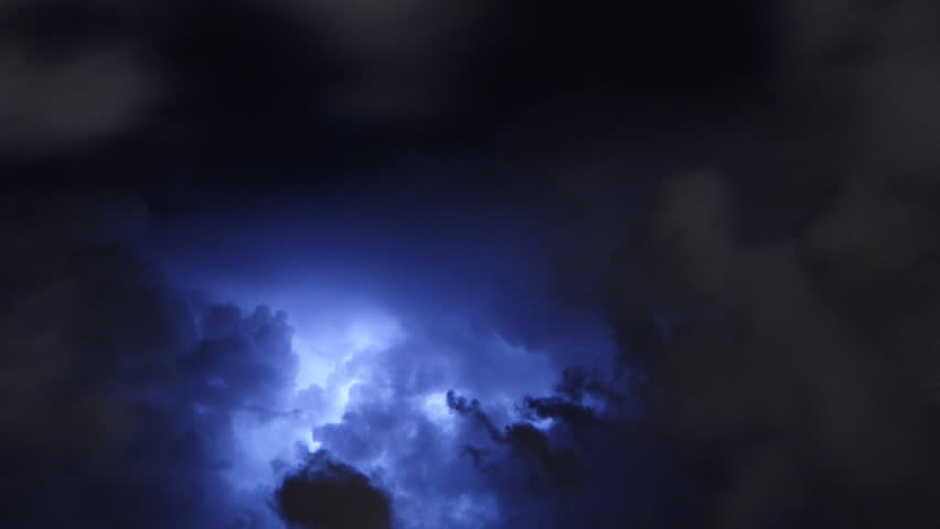 Time lapse of severe thunderstorm clouds at night with lightning