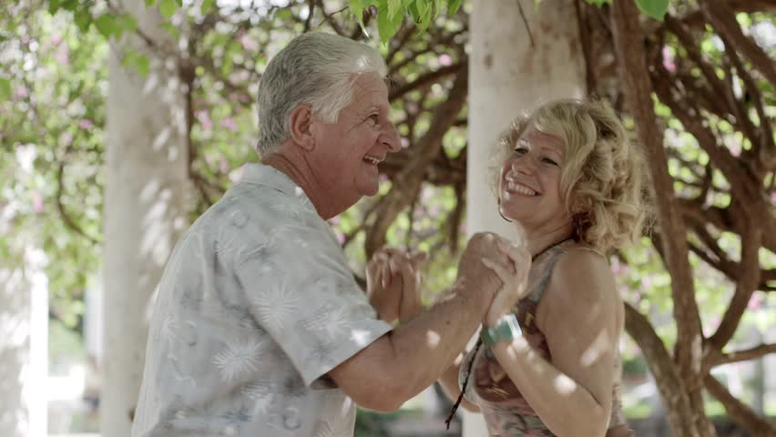 Active retirement and leisure activities, happy old people dancing latin american dance on holidays